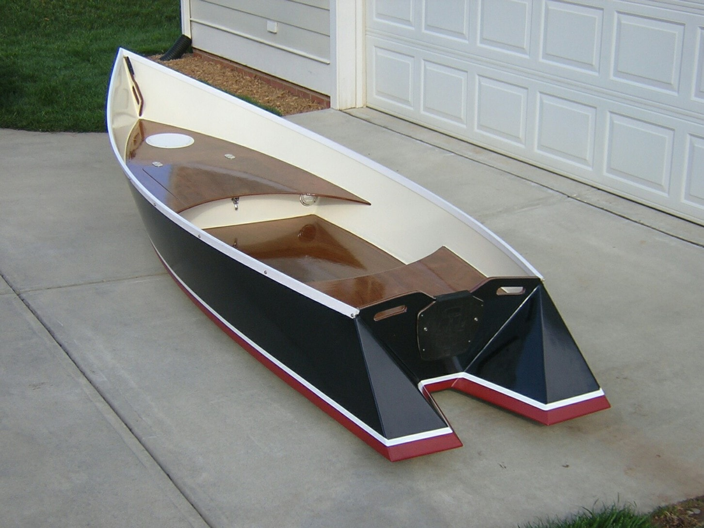 The Original Tango Skiff by Hank Bravo